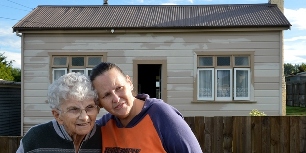 Loading Sherrill Clayton-Reed, who mother died in a single-crewed ambualnce, and her friend Maureen Gallagher (left), outside Sherrill's late mother's house in Kaitangata. Photo / Otago Daily Times