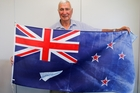 Marcus Wilkins with the flag that adds a silver fern to easily differentiate the New Zealand and Australian flags. Photo / Ruth Keber