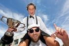 Driver Edu Tremain, 11, and Cam Ward celebrate their win of the sponsor's cup race at the Soapbox Derby in Napier yesterday. Photo / Paul Taylor