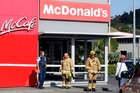 Police and firefighters at the Kamo McDonald's where an elderly driver hit a pedestrian before ploughing into the fast food outlet. Photo / John Stone
