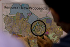 An eastern suburbs resident studies a map of proposed housing density changes. Photo / Dean Purcell
