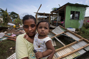 Shahista Bano with her 8-month-old son Ikram. Their home in Lovu Seaside was destroyed after Cyclone Winston hit. Photo / Brett Phibbs