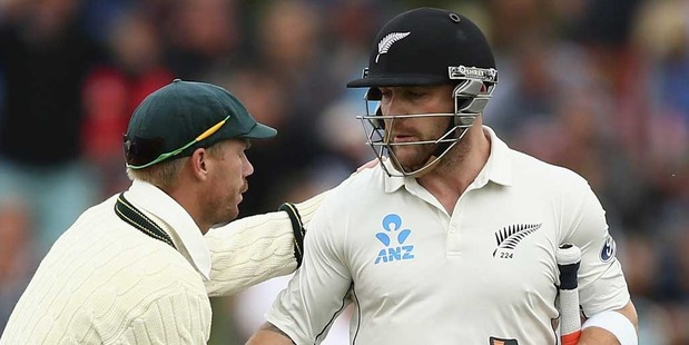 Brendon McCullum of New Zealand is congraulated by David Warner of Australia as he walks from the ground after his final test innings. Photo / Getty Images.