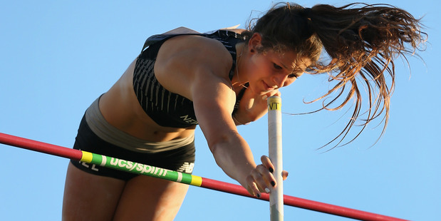 Eliza McCartney of New Zealand clears the bar. Photo / Getty Images