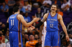 Steven Adams #12 of the Oklahoma City Thunder high fives Enes Kanter #11. Photo - Getty Images