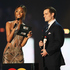 Jourdan Dunn (L) and Henry Cavill present an award. Photo / Getty Images
