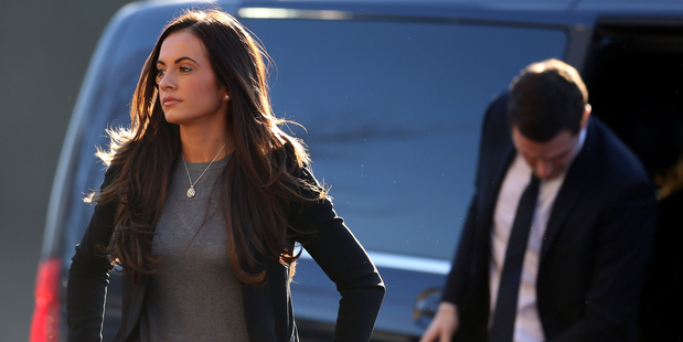 Footballer Adam Johnson arrives with partner Stacey Flounders at Bradford Crown Court. Photo / Getty Images