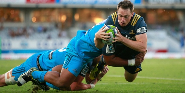 Ben Smith dives over to score for the Highlanders against the Blues. Photo / Getty