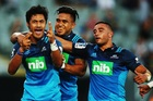 The Blues celebrate a try during their win against the Highlanders. Photo / Getty