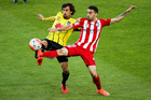 Albert Riera and Anthony Caceres compete for the ball as the Phoenix host Melbourne City. Photo / Getty