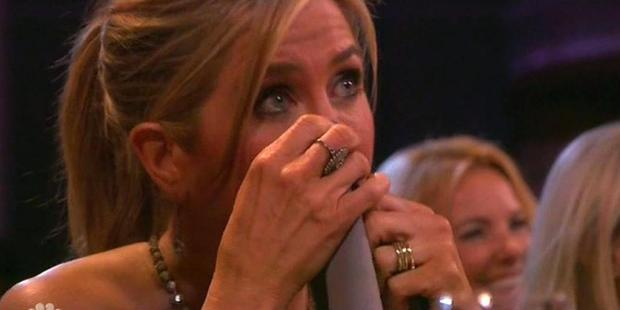 Jennifer Aniston wipes away tears during NBC's TV special dedicated to director James Burrows. Photo/NBC