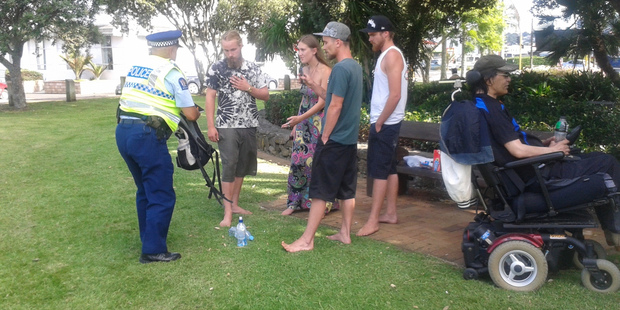 Police search the protesters who gathered at 4.20pm and lit up. Photo / Northern Advocate
