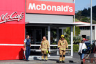 Police and firefighters at the Kamo McDonald's where an elderly driver hit a pedestrian before ploughing into the fast food outlet. PHOTO/JOHN STONE