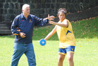 Nigel Edwards gives some discus throwing tips to the promising Talia Kahui AT AGGS throwing academy.