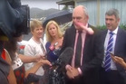 Government minister Steven Joyce is hit in the face by a pink dildo thrown at him in Waitangi. Photo / Newshub