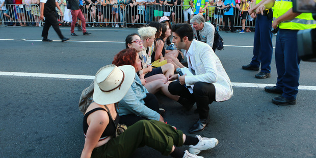 Dancing with the Stars judge Stefano Olivieri tries to talk to demonstrators at Pride Parade. Photo / Norrie Montgomery