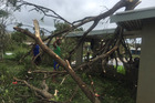 A tree crashed onto the roof of house in Ba, Fiji. Photo: Jay Dayal / Facebook