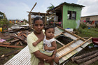 Shahista Bano, with 8-month-old son Ikram, says her family will rebuild their destroyed home. Photo / Brett Phibbs