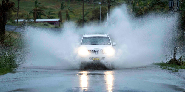 A 4WD drives through flood waters after cyclone Winston hit Fiji caused loss of lives and extensive damage to the north west side of the Viti Levu in Fiji. Photo / Brett Phibbs