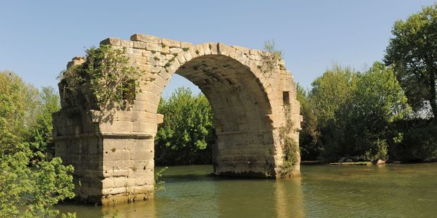 Ambrussum Bridge on the Vidourle River in Languedoc Roussillon, France.