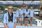 Members of the Mount Maunganui Swimming Club team that competed at the New Zealand Junior Swimming Championships: (Front) Ruby Helm, 10, (L-R) Poppy Wilson, 10, Kel Iggulden, 11, Scott Bartlett, head coach, Gus Shivnan, 11, Lucy Bartlett, 11. Photo / George Novak