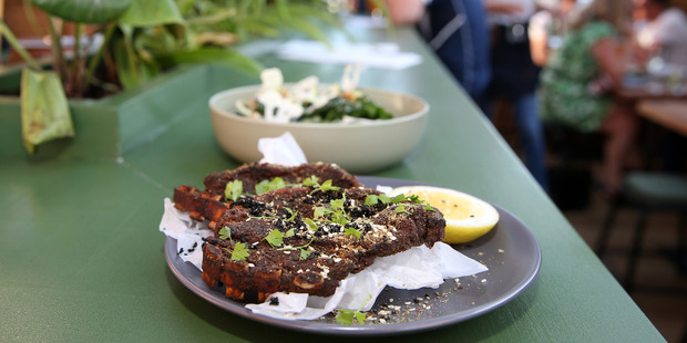 North African spiced lamb chops and wilted silverbeet salad. Photo / Fiona Goodall