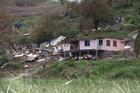 One house survives, the other taken, in the town of Rakiraki, after Cyclone Winston hit Fiji. Photo / Brett Phibbs