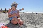 Michela Avent enjoys the beach with her grandson Christian Palmer, 2.Photo/George Novak