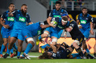 Blues flanker Blake Gibson charges into Highlanders lock Joe Wheeler after stripping possession from Highlanders replacement Dan Pryor. Photo / Getty Images