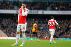Arsenal's Olivier Giroud reacts after he failed to score during the English FA Cup soccer match between Arsenal and Hull City. Photo / AP.