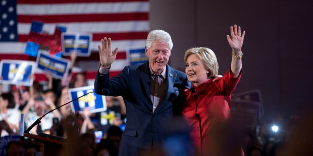 Former President Bill Clinton and Democratic presidential candidate Hillary Clinton wave after Hillary Clinton's victory speech for the Nevada caucuses. Photo / AP