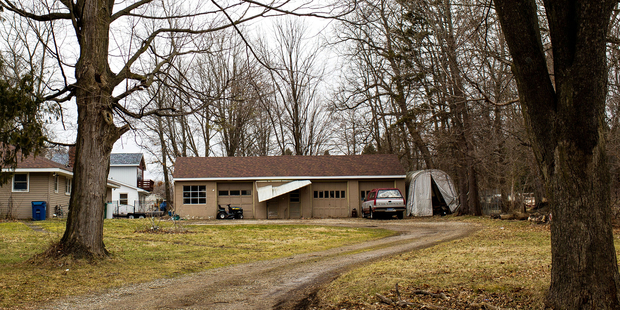 The exterior of Jason Brian Dalton's residence is seen on the corner of West East Avenue and Douglas Avenue in Cooper Township, Mich. Photo / AP