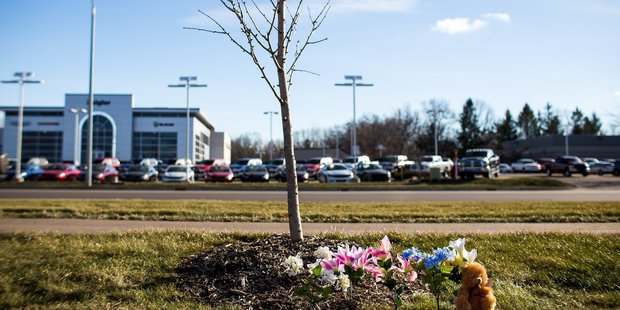 Flowers lie next to a makeshift memorial after the shooting. Photo / AP