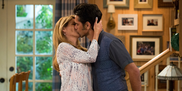 Lori Loughlin and John Stamos in a scene from, Fuller House, streaming on Netflix beginning on Friday, Feb 26. Photo / AP