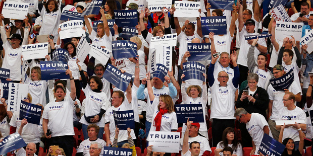 Supporters of Donald Trump cheer. Photo / AP
