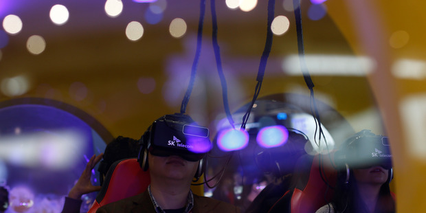 A man uses virtual reality glasses during the Mobile World Congress wireless show. Photo / AP
