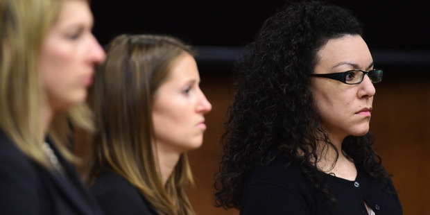 Defense attorneys stand with Dynel Lane as she is found found guilty of attempted first-degree murder, assault and unlawful termination of a pregnancy. Photo / AP