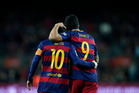 FC Barcelona's Luis Suarez, right, is congratulated by his teammate Messi. Photo / AP.