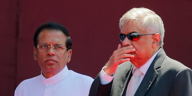 John Key will meet Sri Lankan President Maithripala Sirisena (left) and Prime Minister Ranil Wickremesinghe. Photo / AP