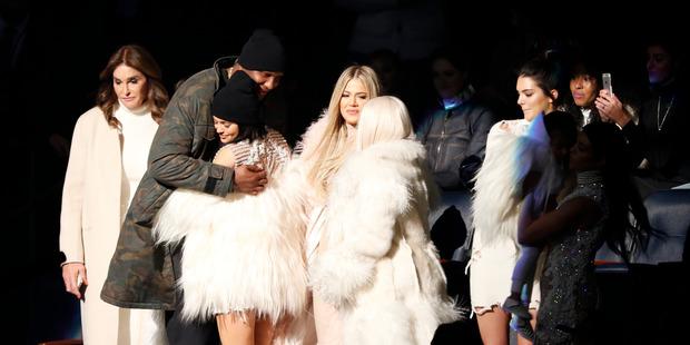 Lamar Odom hugs Kylie Jenner as Caitlyn Jenner, left, Khloe Kardashian Odom, center, Kim Kardashian, Kendall Jenner, North West and Kourtney Kardashian look on.