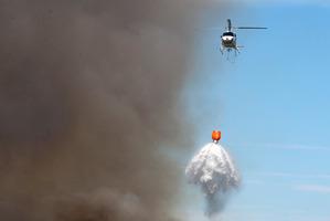 Three helicopters battled a scrub fire on Karikari Peninsula.