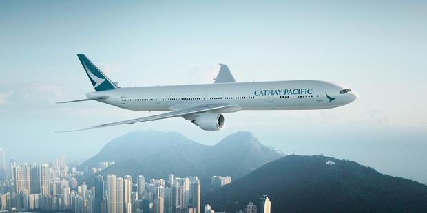 Cathay Pacific plane over Hong Kong.
