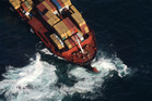 The stricken container ship, Rena, stuck on Astrolabe Reef off, Motiti Island, on October 5, 2011. Photo/Joel Ford