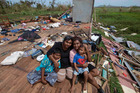 DESPERATE: A Northland appeal has been set up to help victims of Cyclone Winston in Fiji, like Sanjogeeta Kiran, right, with her sister Sulva Kiran (in black) and her son Shivendera, 10, and 2-year-old Raajeen. They all sheltered under the house at their home in RakiRaki, which was totally destroyed after the cyclone hit last weekend.