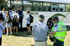 CRIME SCENE: Police talk to students and the bus driver after an altercation in Havelock North yesterday. PHOTO FILE