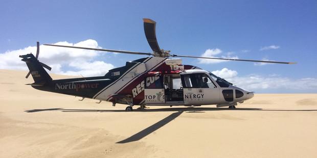 Crew attend injured paramotorer.