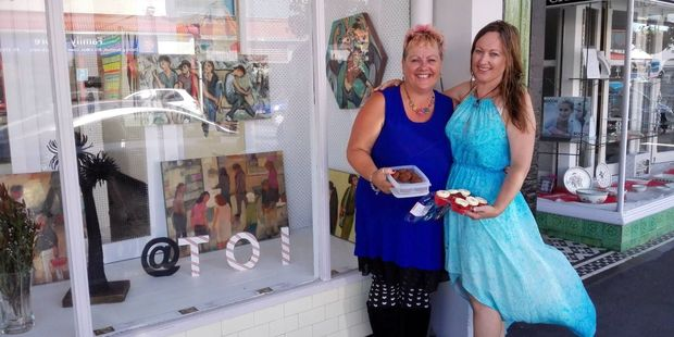 Toi Wairarapa co-ordinator Corrinne Oliver with baking from Givealittle Kindness for Carterton organiser Karyn Parker after Toi's High St gallery was broken into. PHOTO/FACEBOOK