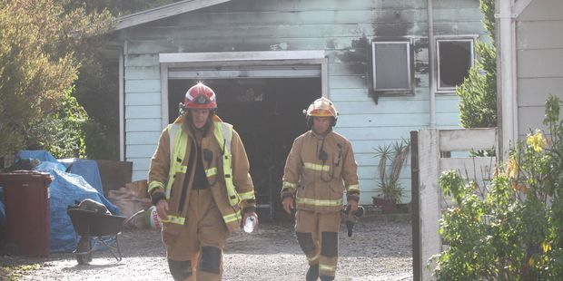 Masterton firefighters leave the scene of a sleepout fire on Totara St in Masterton. PHOTO/ANDREW BONALLACK