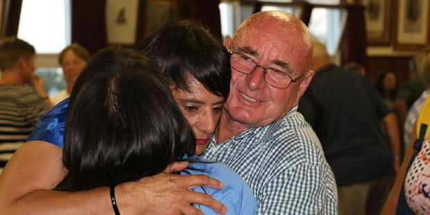 Gina and George Taylor congratulate Lee Carter, centre, after a meeting that confirmed her leadership of the Featherston Community Board. PHOTO/HAYLEY GASTMEIER