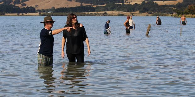Volunteer Geoff Thurston and freshwater scientist Amber McEwan discuss kakahi (native freshwater mussel) sampling at Lake Wairarapa. PHOTO/SUPPLIED